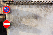 Stop Sign Prints - Two Traffic Signs On A Wall In The Town Print by Don Mason