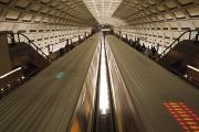 Metro Journey Posters - Two Trains Passing In The Dupont Circle Poster by Rich Reid