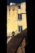 Yellow Building Prints - Two Windows in Lisbon Print by John Rizzuto