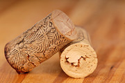 Stopper Prints - Two wine corks resting on a wood surface Print by David Smith