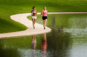 Joggers Posters - Two Women Jogging Poster by Utah Images