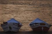 Grand Canyon Scenes Prints - Two Wooden Dories On The Shore Print by Dugald Bremner Studio