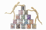 Can Prints - Two Wooden mannequins on worldwide banknotes pyramid Print by Sami Sarkis