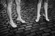 Working Girls Framed Prints - Two Young Women Wearing High Heeled Shoes And Fake Tan On Cobblestones On A Night Out In Dublin  Framed Print by Joe Fox