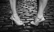 Working Girls Framed Prints - Two Young Women Wearing High Heeled Shoes And Fake Tan On Cobblestones On A Night Out Framed Print by Joe Fox