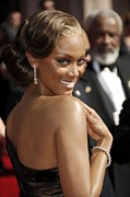 Hair Bun Framed Prints - Tyra Banks At Arrivals For 58th Annual Framed Print by Everett