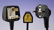 Alternating Current Photos - Uk, Us And European Mains Plugs by Sheila Terry