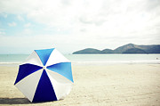 Beach Umbrella Framed Prints - Umbrella On Sand Framed Print by Grace Oda