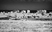 Deryneia Prints - UN border patrol driving through the heat haze in the UN buffer zone in the green line famagusta Print by Joe Fox