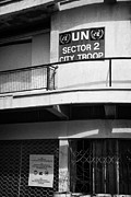 Stop Sign Prints - UN sector 2 city troop and post UN66 in the restricted area of the UN buffer zone in nicosia cyprus Print by Joe Fox