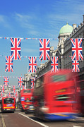 Road Travel Framed Prints - Union Jack Flags On Regent Street; London; England Framed Print by Laurie Noble