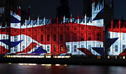 London Prints Posters - Union Jack on Parliament Poster by John Rizzuto