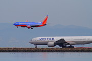 Landing Jet Framed Prints - United Airlines And Southwest Airlines Jet Airplane At San Francisco International Airport SFO.12087 Framed Print by Wingsdomain Art and Photography