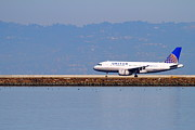 Landing Jet Framed Prints - United Airlines Jet Airplane At San Francisco International Airport SFO . 7D11998 Framed Print by Wingsdomain Art and Photography