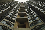 Urban Scenes Photos - Upward View Of A Public Housing by Justin Guariglia