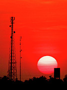 Electricity Posters - Urban Sunset And Radiostation Tower Silhouettes Poster by Rosita So Image