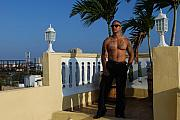 Shirtless Framed Prints - Urban Tropical Male Top of the World Model and Tattoos Framed Print by Heather Kirk