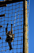 Netting Prints - U.s. Air Force Airman Climbing Net Print by Stocktrek Images