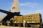 Military Base Framed Prints - U.s. Air Force Airmen Load Cargo Onto Framed Print by Stocktrek Images