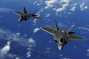 Guam Prints - U.s. Air Force F-22 Raptors In Flight Print by Stocktrek Images