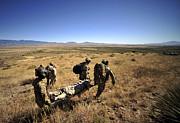 U.s. Air Force Pararescuemen Carry Print by Stocktrek Images