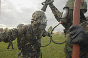 Biochemical Art - U.s. Air Force Soldier Decontaminates by Stocktrek Images