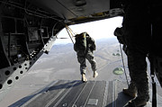 Stunt Posters - U.s. Airmen Jump From A Ch-47 Chinook Poster by Stocktrek Images
