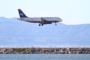 Airplane Framed Prints - US Airways Jet Airplane Landing At The Oakland Airport . 7D11058 Framed Print by Wingsdomain Art and Photography