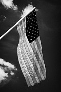 Tenn Prints - Us American Flag On Flagpole Against Blue Cloudy Sky Usa Print by Joe Fox