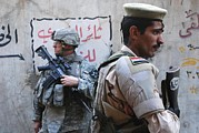 Baghdad Posters - Us And Iraqi Army Soldiers Stand Guard Poster by Everett
