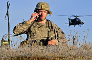 On The Phone Prints - U.s. Army Captain Directs An Ah-64 Print by Stocktrek Images