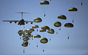 Flying Planes Posters - U.s. Army Paratroopers Jumping Poster by Stocktrek Images