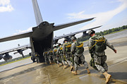 In A Row Art - U.s. Army Rangers Board A U.s. Air by Stocktrek Images