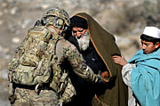 Camouflage Clothing Posters - U.s. Army Sergeant Helps A Town Elder Poster by Stocktrek Images