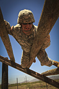 Uniforms Metal Prints - U.s. Army Soldier Climbs Over An Metal Print by Stocktrek Images