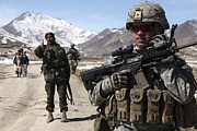 Foot Patrol Photos - U.s. Army Soldier Conducts A Patrol by Stocktrek Images
