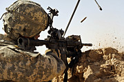 Assault Rifles Photo Framed Prints - U.s. Army Soldier Engages Enemy Forces Framed Print by Stocktrek Images
