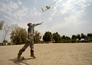 Baghdad Framed Prints - U.s. Army Soldier Launches An Rq-11b Framed Print by Stocktrek Images