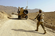 Dirt Roads Photos - U.s. Army Soldier Moves To His Mrap by Stocktrek Images