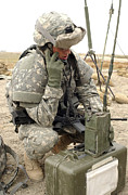 Kneeling Prints - U.s. Army Soldier Performs A Radio Print by Stocktrek Images