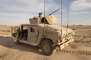 M1114 Photos - U.s. Army Soldier Pulls Security On Top by Stocktrek Images