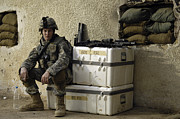 Sacks Framed Prints - U.s. Army Soldier Relaxing Before Going Framed Print by Stocktrek Images