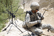 Uniforms Posters - U.s. Army Soldier Sets Up A Tactical Poster by Stocktrek Images