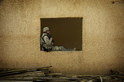 Ledge Photo Posters - U.s. Army Soldier Takes A Break Poster by Stocktrek Images