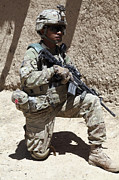 Logar Framed Prints - U.s. Army Soldier Takes A Knee While Framed Print by Stocktrek Images