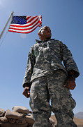 American Flags Prints - U.s. Army Soldier Taking In The Sun Print by Stocktrek Images