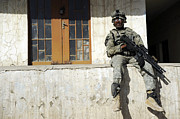 Ledge Photo Posters - U.s. Army Soldier Visiting An Iraqi Poster by Stocktrek Images