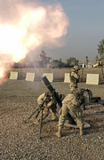 Mortar Posters - U.s. Army Soldiers  Fire A 120mm M120 Poster by Stocktrek Images