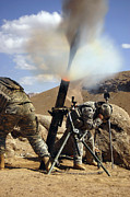 Uniforms Posters - U.s. Army Soldiers Firing A 120mm Poster by Stocktrek Images