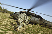Uh-60 Black Hawk Prints - U.s. Army Soldiers Prepare To Board Print by Stocktrek Images